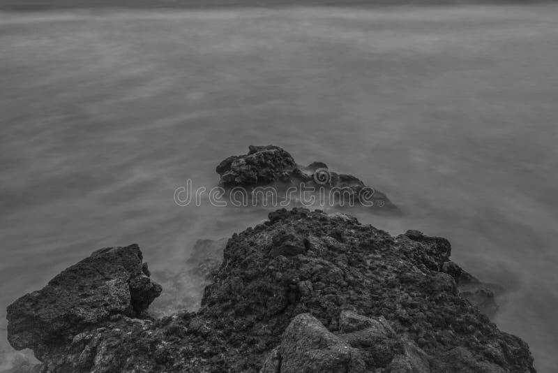 Breaking Waves Making Rocks stock photos