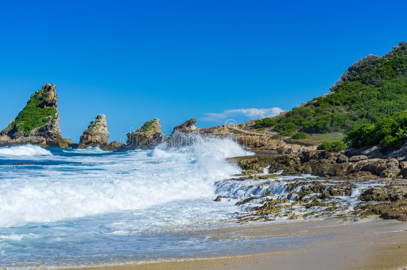 Breaking waves at rocks of the coast near Pointe des chateaux, Guadeloupe. Caribbean stock photo