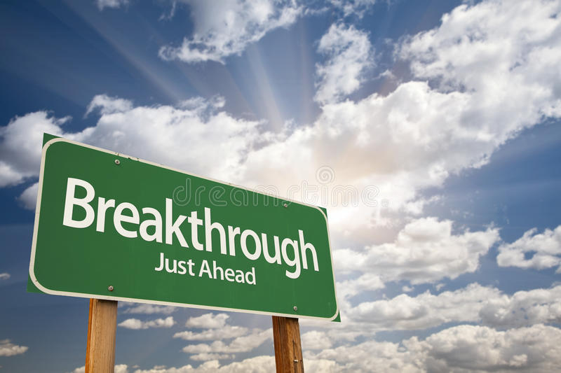 Breakthrough Green Road Sign. With Dramatic Clouds and Sky royalty free stock images