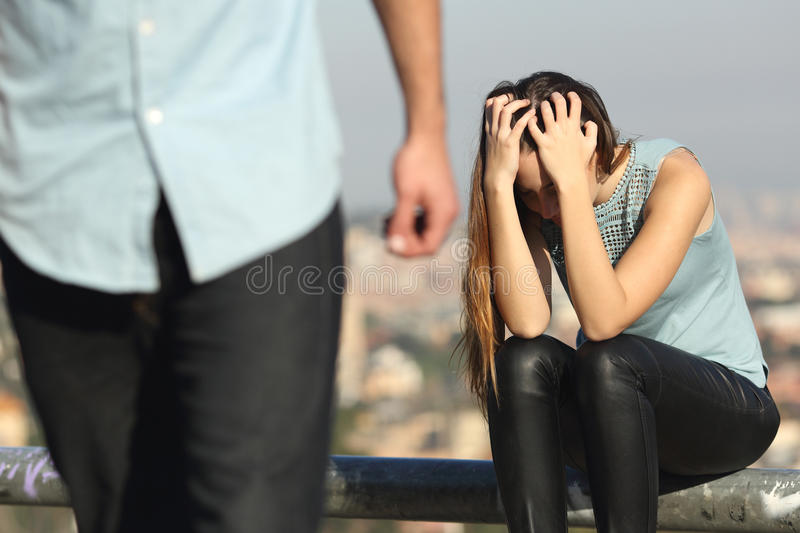 Breakup of a couple with bad guy and sad girlfriend royalty free stock photography