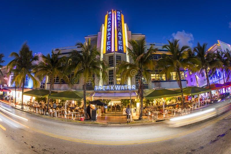 Breakwater Hotel at Miami's Ocean Drive at night stock images
