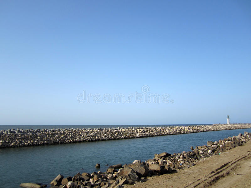 Breakwater And Lighthouse Royalty Free Stock Images
