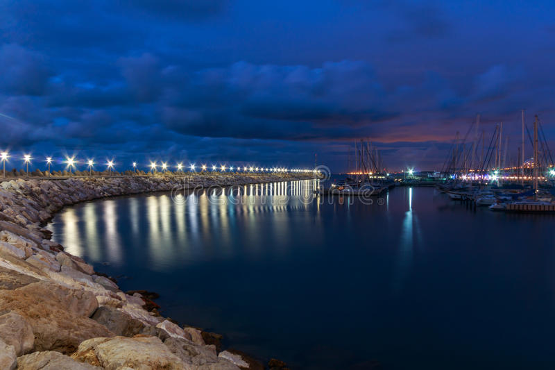 Breakwater , Lights on the water at Night Overcast in the marina. Ashkelon. Israel. Lights on the water at Night, in Ashkelon Israel royalty free stock image