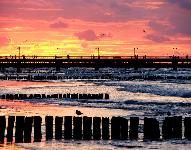 Breakwater and sunset. The photography of breakwater during sunset with jetty in the background. Taken in Poland on 2010 stock photos