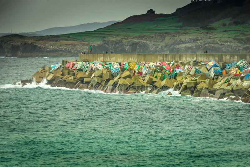 Breakwaters Memory cubes, Llanes, Asturias. Cloudy day in breakwaters Memory cubes, Llanes, Asturias stock photos