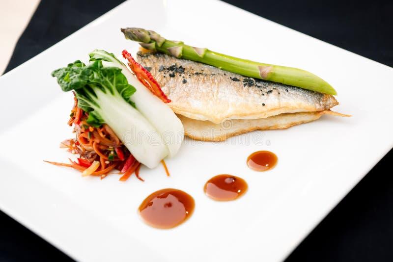 Bream fish. With asparagus, vegetables, fried wok and Teriyaki sauce stock photos