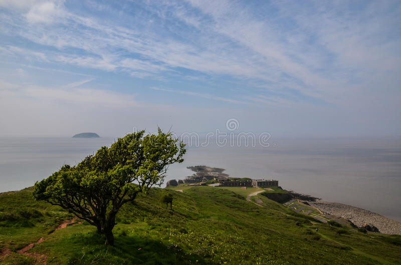 Brean Down, Somerset. Brean Down is a promontory off the coast of Somerset standing 318 feet high and extending 1.5 miles into the Bristol Channel at the eastern stock photos
