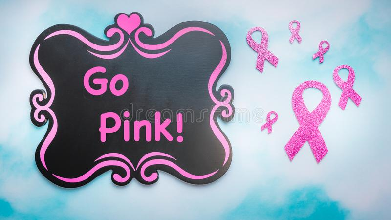 Breast Cancer Awareness ribbons and chalkboard Go Pink. Breast Cancer Awareness Month pink ribbons and chalkboard Go Pink stock images