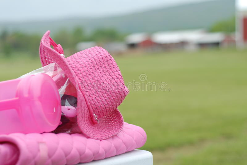 Breast Cancer Benefit. Pink cowboy hat and saddle pad for Breast Cancer Benefit horse show royalty free stock photo
