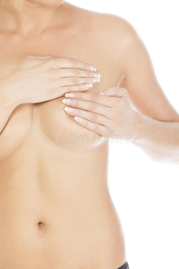 Breast cancer concept. Breast cancer, woman holding her breast, isolated on white background stock image