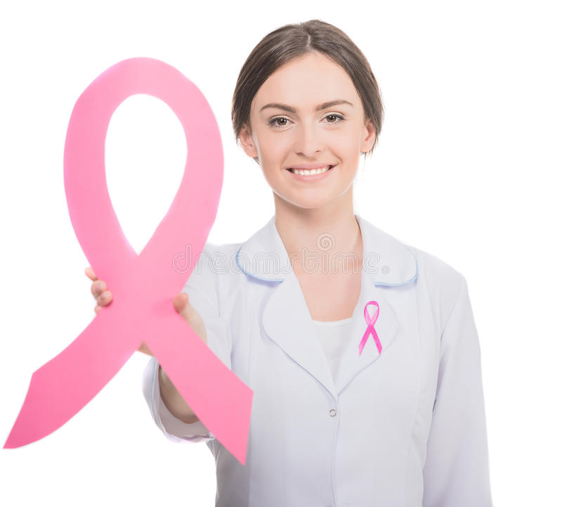 Breast cancer. Healthcare and medicine concept - female doctor with pink breast cancer awareness ribbon royalty free stock photos