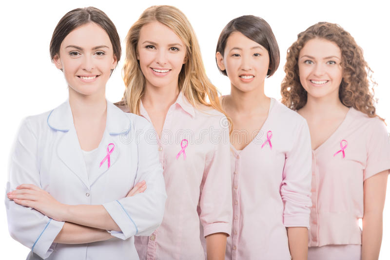 Breast cancer. Healthcare and medicine concept - group of smiling women and doctor in blank t-shirts with pink breast cancer awareness ribbons stock photo