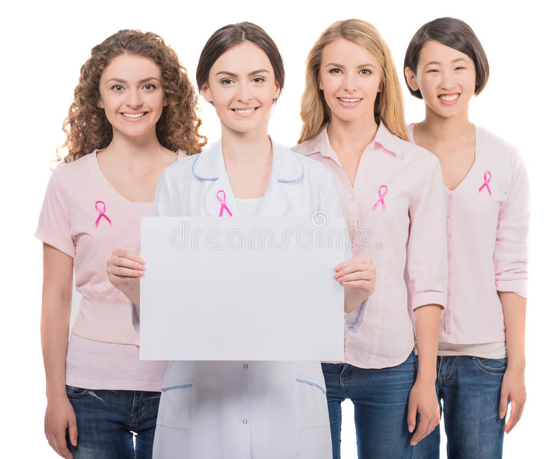 Breast cancer. Healthcare and medicine concept - group of smiling women and doctor in blank t-shirts with pink breast cancer awareness ribbons royalty free stock images