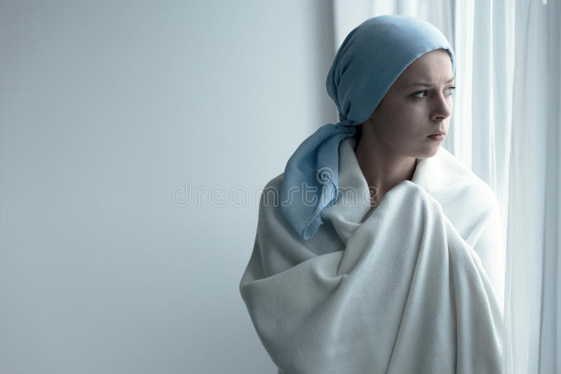 Breast cancer patient in blanket stock photo