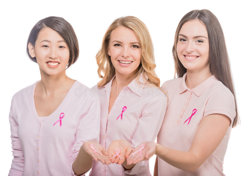 Breast cancer. Portrait of happy female volunteers supporting breast cancer awarenes, white background royalty free stock image