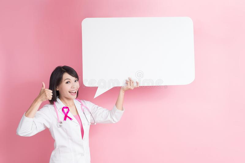 Breast cancer prevent concept. Woman doctor take speech bublle and thumb up with breast cancer prevent concept stock photography