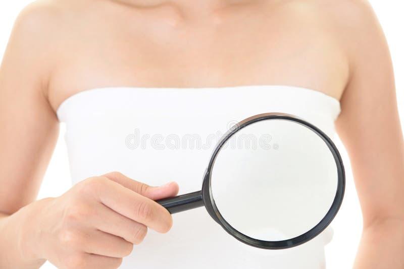 Woman examining her breast royalty free stock photo