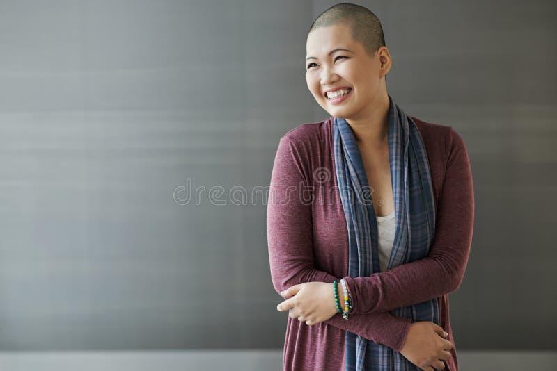 Breast cancer survivor. Portrait of happy Vietnamese breast cancer survivor stock photos