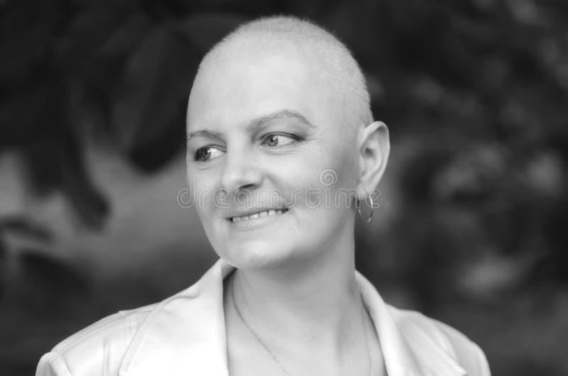 Breast cancer survivor with positive attitude. Portrait of the breast cancer survivor with positive attitude royalty free stock photos