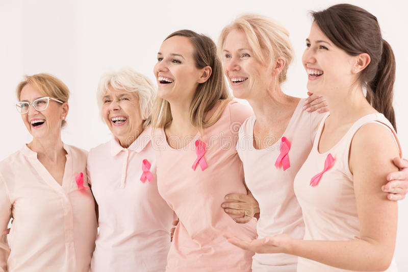 Breast cancer survivors. Happy breast cancer survivors supporting each other royalty free stock photo