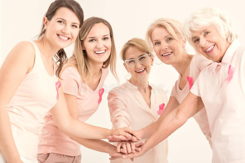 Breast cancer unity and friendship stock photography