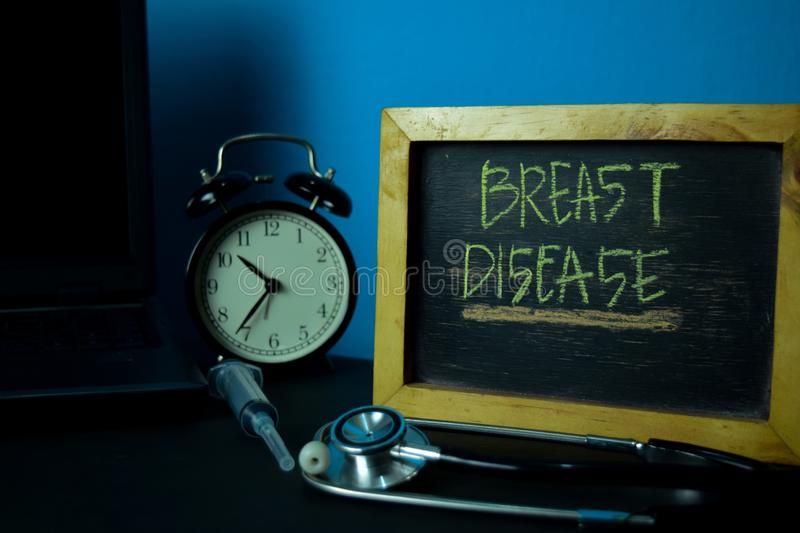 Breast Disease Planning on Background of Working Table with Office Supplies. stock photo
