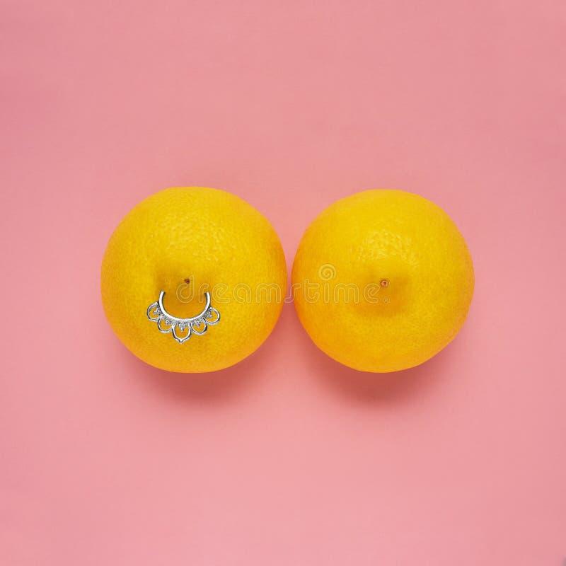 Breast piercing stock photos