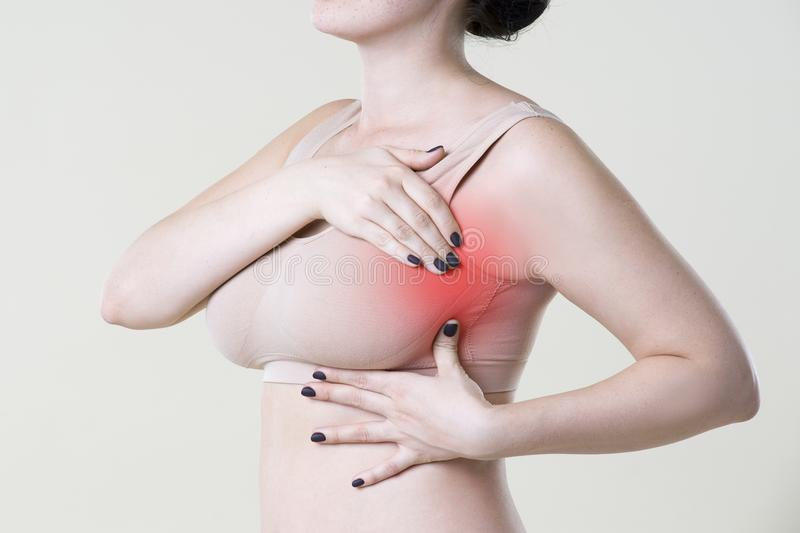Breast test, woman examining her breasts for cancer, heart attack, pain in human body stock images