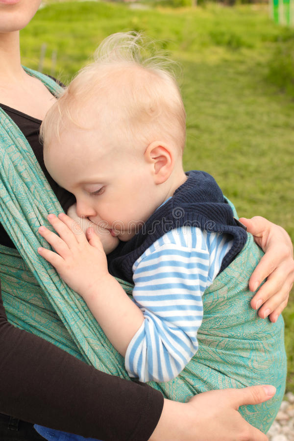 Download Breastfeeding In Baby Sling Outdoors Stock Images - Image: 35134244