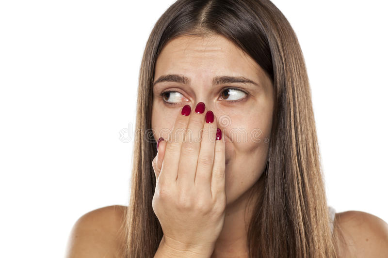 Breath checking. Young woman checking her breath with her hand stock image