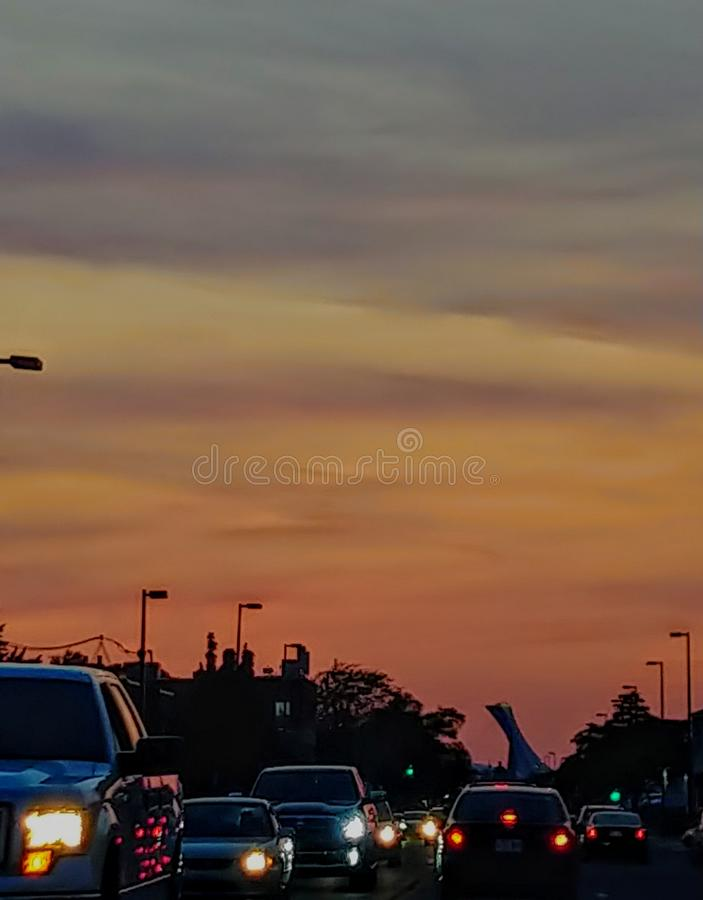 Breathaking sunset on Chambly Street in Longueuil, Quecbec, Canada. Cars, lights, evening, orange, busy, traffic, trafic stock photo