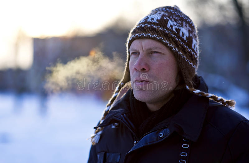 Breathing man in winter royalty free stock image