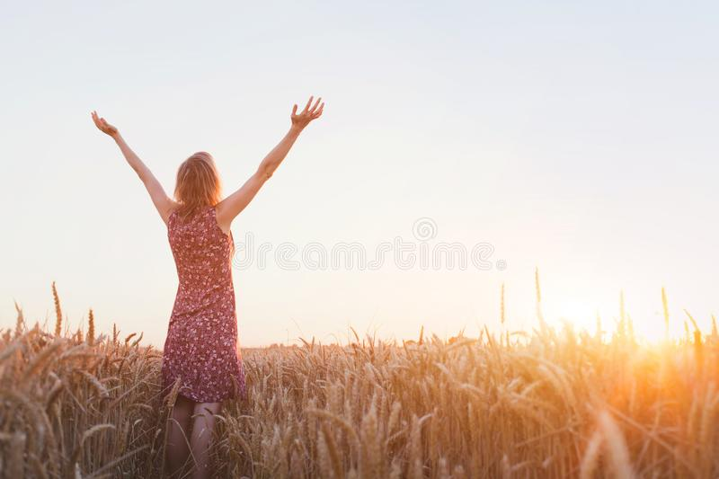 Breathing, woman with raised hands enjoying life stock photography