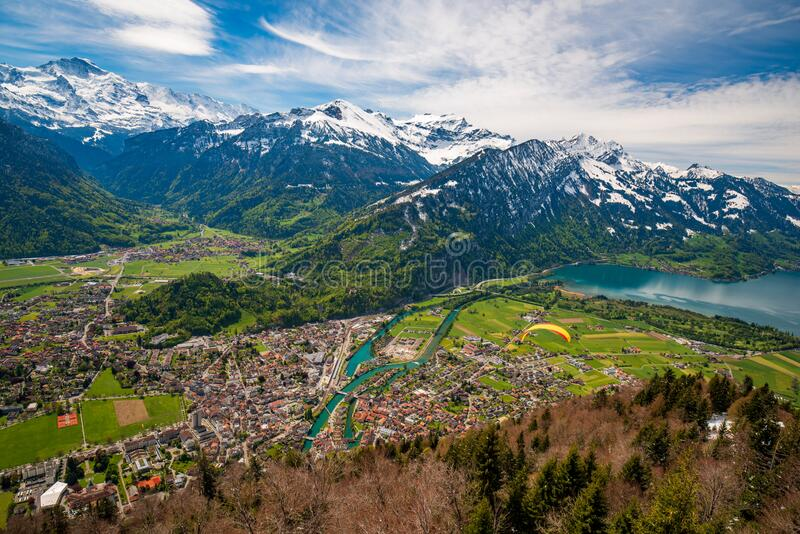 Breathtaking aerial view over Interlaken and Swiss Alps from Harder Kulm View point, Switzerland. Breathtaking aerial view over Interlaken and Swiss Alps from stock photo