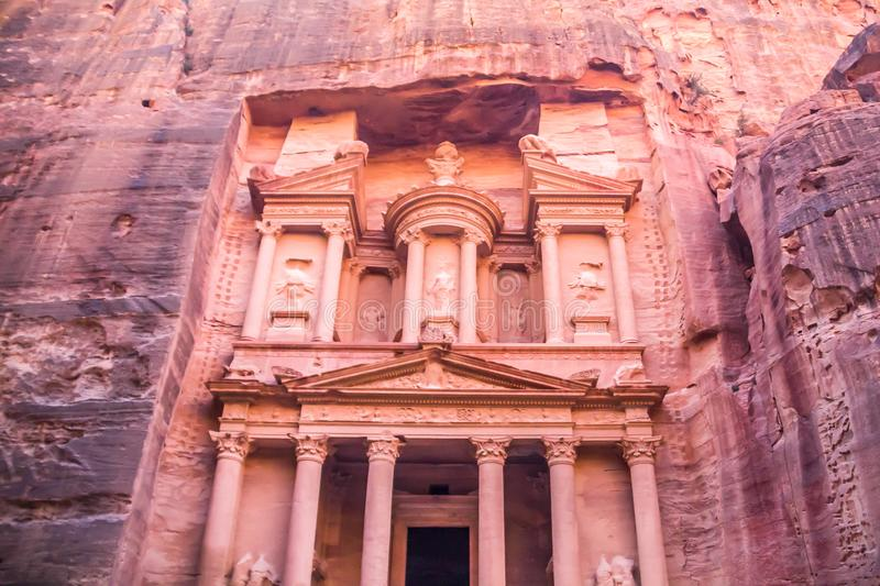 Breathtaking `Al-Khazneh` : the Treasury as it reveals in its full glory to the walkers in canyon `al-Siq`. Petra. The capital of the Nabatean Kingdom.The royalty free stock photo