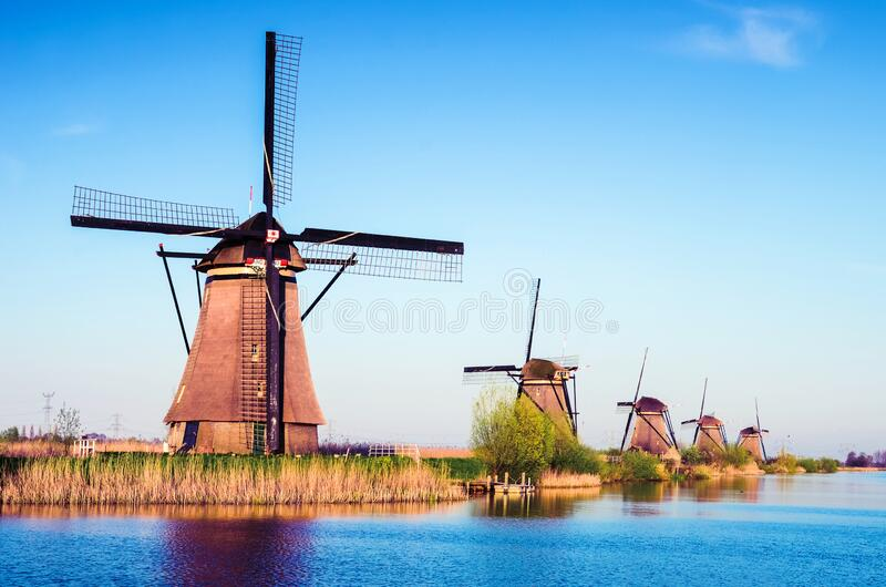 Breathtaking beautiful inspirational landscape with windmills in Kinderdijk, Netherlands. Fascinating places, tourist attraction.  royalty free stock photography