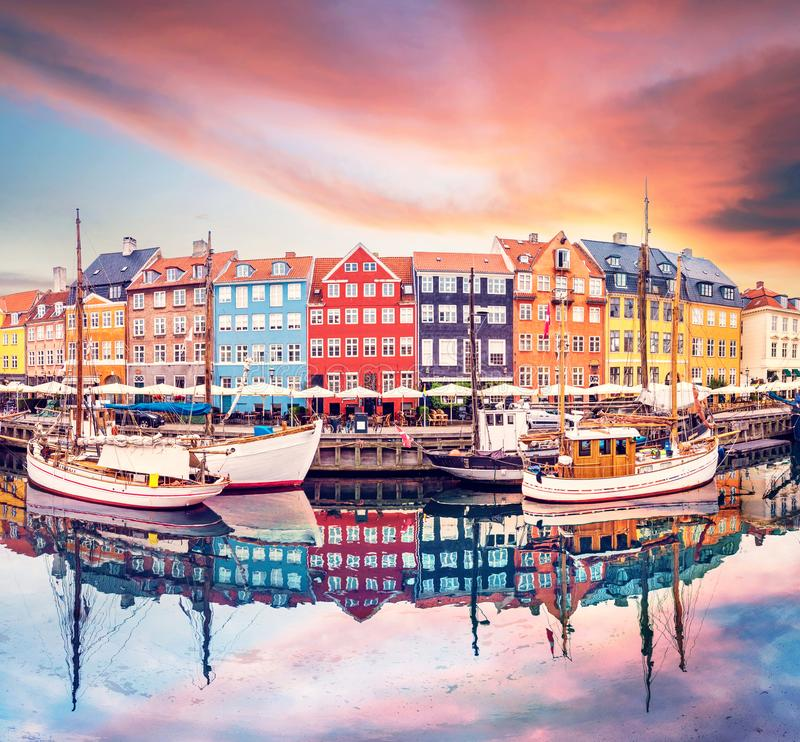 Breathtaking beautiful scenery with boats in the famous Nyhavn in Copenhagen, Denmark at sunrise. Exotic amazing places. Popular royalty free stock images