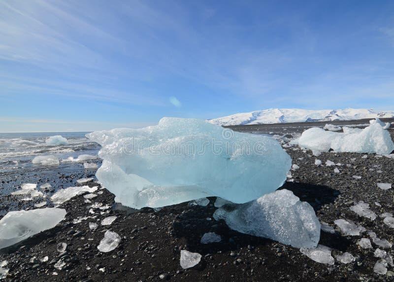 Breathtaking chunk of an iceberg on the beach. Breathtaking chunk of a large iceberg on the beach stock photos