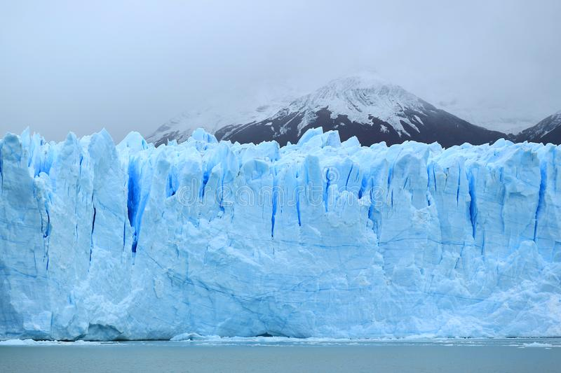 Breathtaking huge ice blue wall of Perito Moreno Glacier in the Los Glaciares National Park, El Calafate, Argentina. Breathtaking huge ice blue wall of Perito stock image