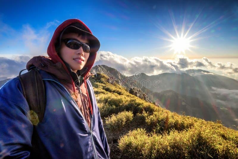 Young man climbs to top of taiwan mountain stock image