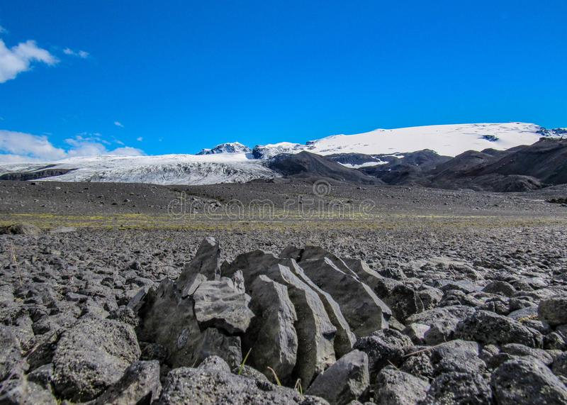 Volcanic rock and Vatnajokull glacier in Kverkfjoll, Highlands of Iceland, Europe stock photo