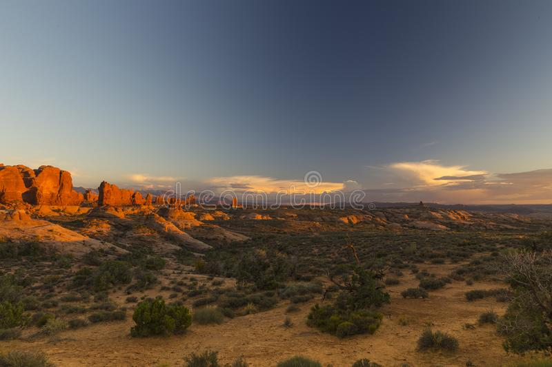 Breathtaking panoramic view of Arches National Park at sunset stock images