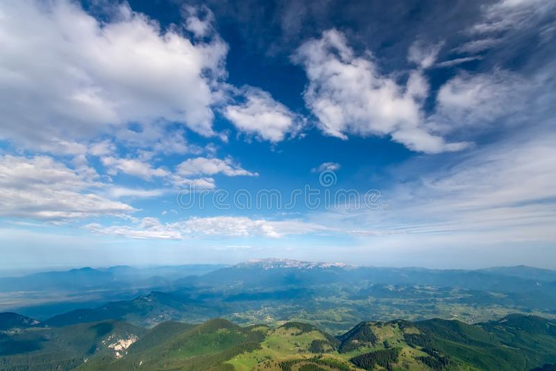 Breathtaking panoramic view of magnificent Rucar-Bran area between the Piatra Craiului and Bucegi mountains in the Romanian stock photos