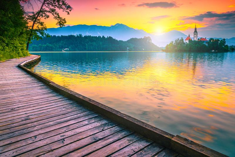 Breathtaking Pilgrimage church and lake Bled at sunrise, Slovenia, Europe stock photos