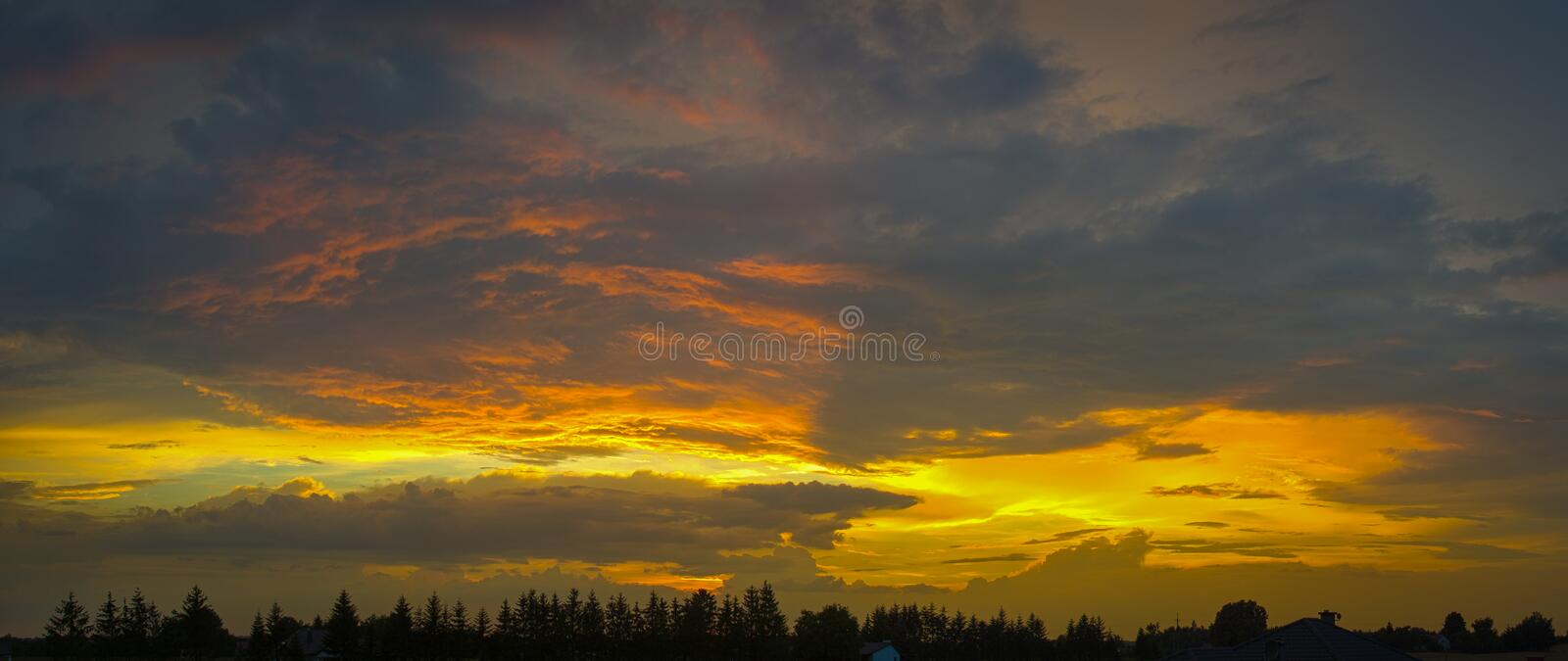 Breathtaking sunset in HDR. At village stock photos