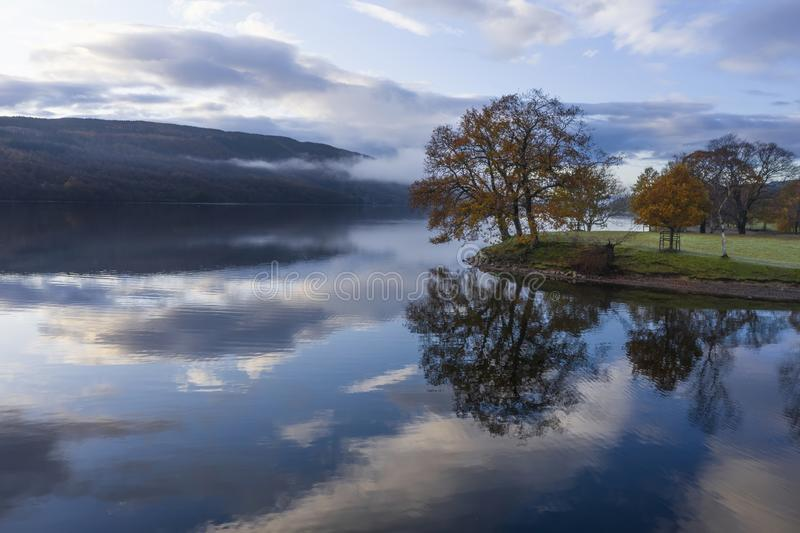Breathtaking vibrant aerial drone landscape images over Coniston Water at sunrise on beautiful Autumn Fall morning royalty free stock images