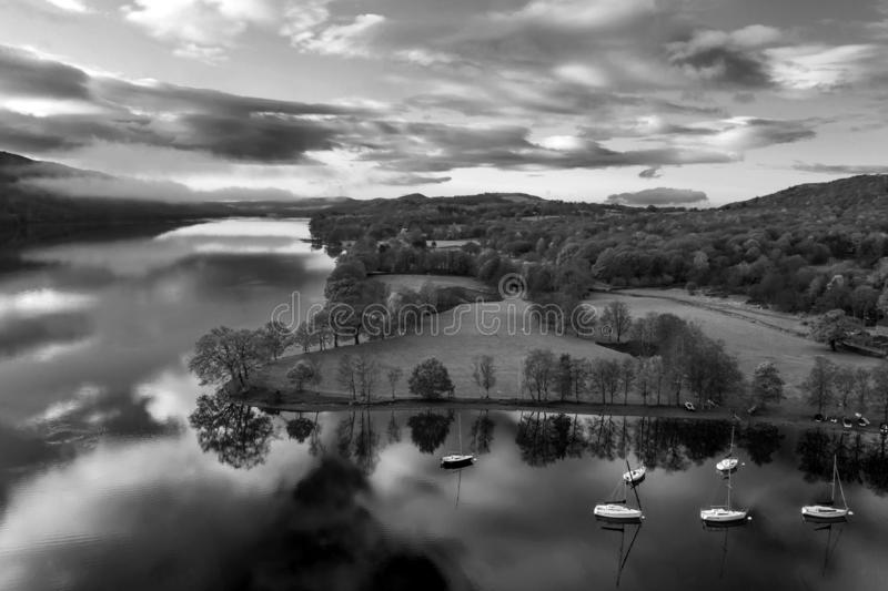 Breathtaking vibrant aerial drone landscape images over Coniston Water at sunrise on beautiful Autumn Fall morning royalty free stock photography