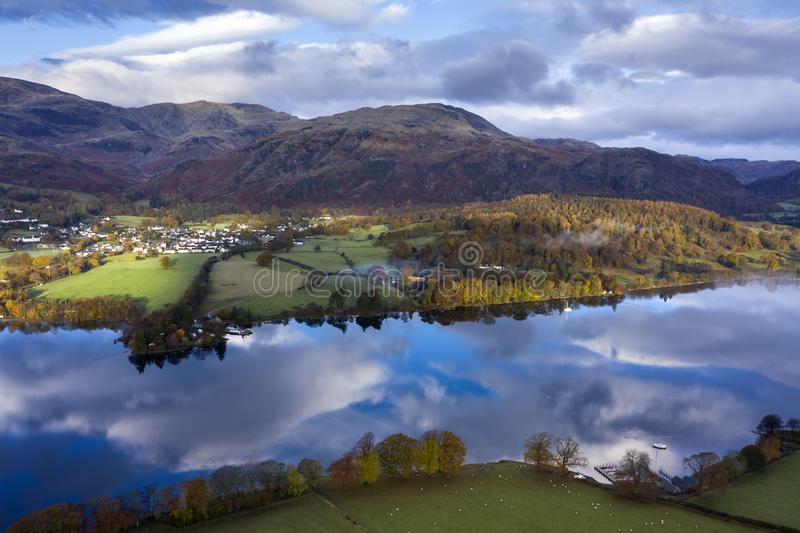 Breathtaking vibrant aerial drone landscape images over Coniston Water at sunrise on beautiful Autumn Fall morning royalty free stock photos