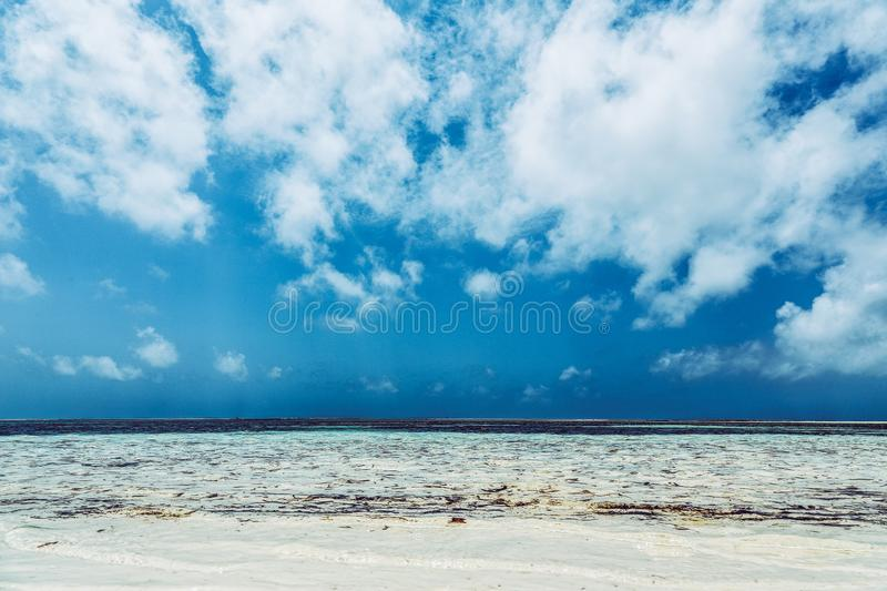 Breathtaking view of beautiful sea waves under the white cloudy sky - great for gorgeous background. A breathtaking view of beautiful sea waves under the white royalty free stock photo