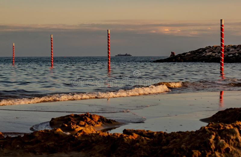 Breathtaking view of the cavallino treporti beach, right on the border with the most famous beach of Jesolo. The poles mark the bo. Undary stock image